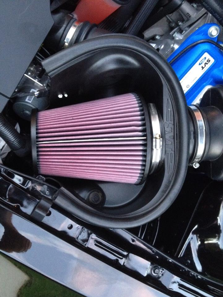 The OEM paper filter was replaced with this K&N air filter